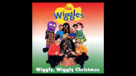 the wiggles wags is bouncing around the christmas tree