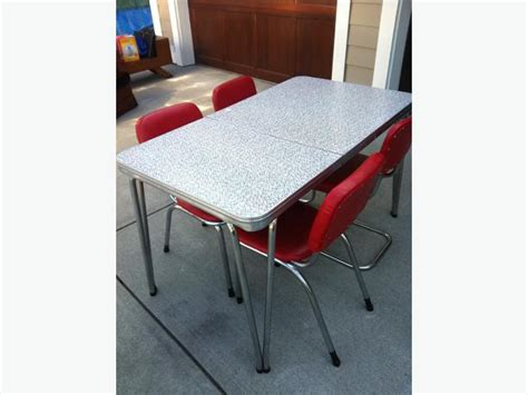 retro chrome and arborite table and chairs outside