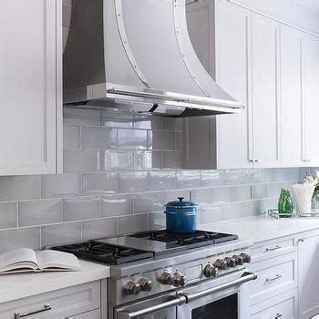 beveled subway tile kitchen white and gray kitchen with gray leather counter stools 4617