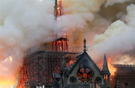 notre dame fire france  crying    world