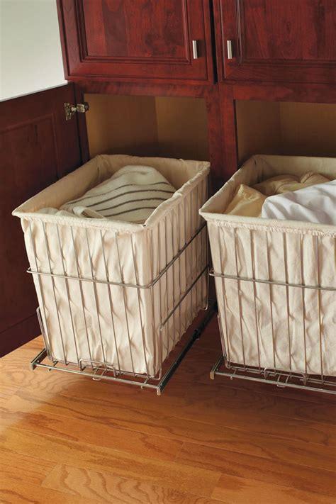 linen closet  removable hamper kemper cabinetry