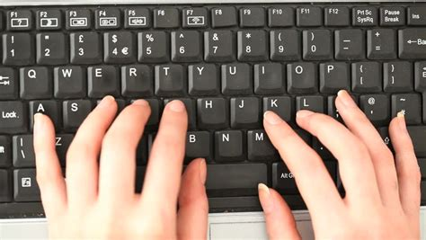 Close Up Of Young White Woman Hands Typing On Computer