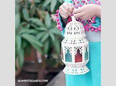 Girl in beautiful dress holding lantern