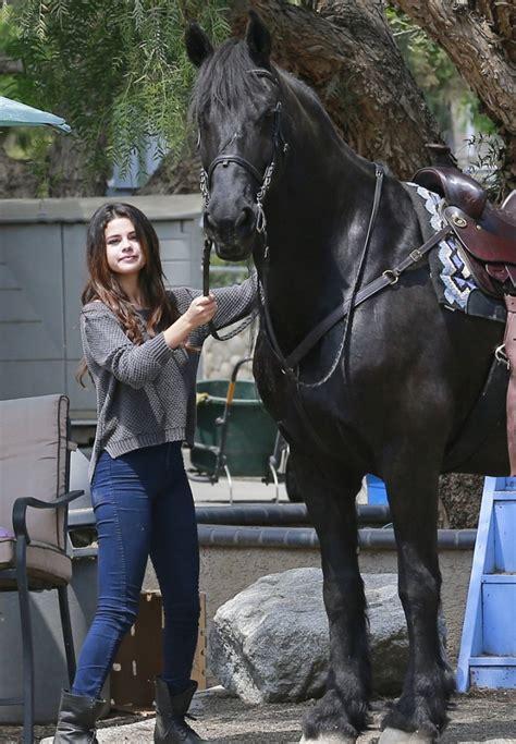 selena riding jeans horse skinny gomez spotted denimology