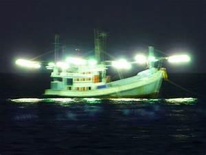 squid boat at night