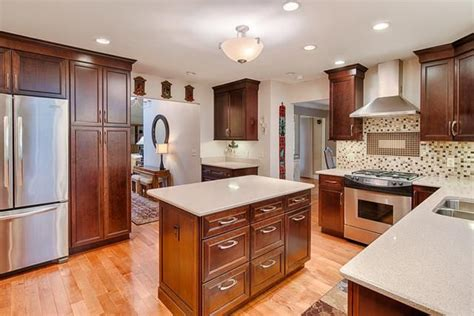 stunning  kitchen featuring kraft maid cherry cabinets