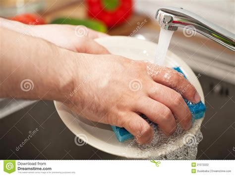 kitchen faucet plate 39 s washing dishes stock photo image of indoor