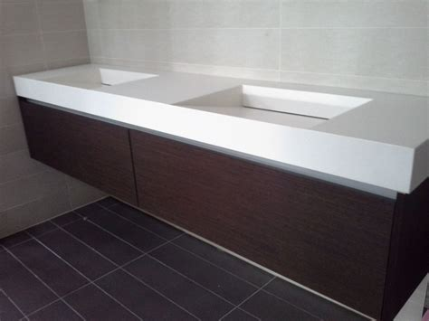 floating vanity white corian top  integrated sinks
