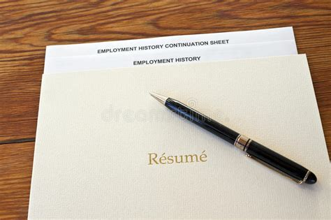 resume folder with pen and employment history stock image