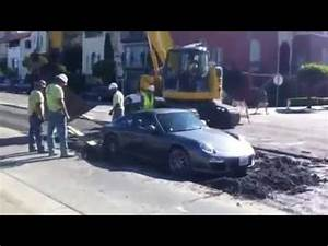 Porsche in wet cement. (For licensing or usage, contact ...