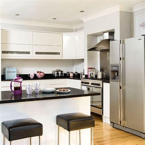 Modern White Kitchen With Black Granite Worktops Kitchen