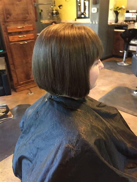 blunt angled bob with heavy bangs beauty by allison fort