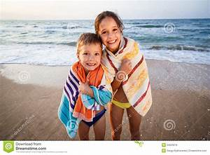 Two Smiling Kids On The Beach Stock Image - Image: 34523019