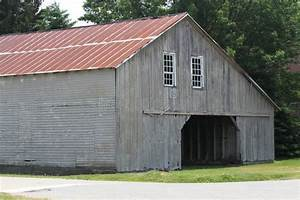 weathered grey amish barn with red metal roof stock photo With amish steel buildings