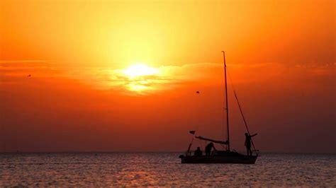 Sailboat At Sea by Boat At Sunset Yacht Sailing At Sea Sunset Sailboat At