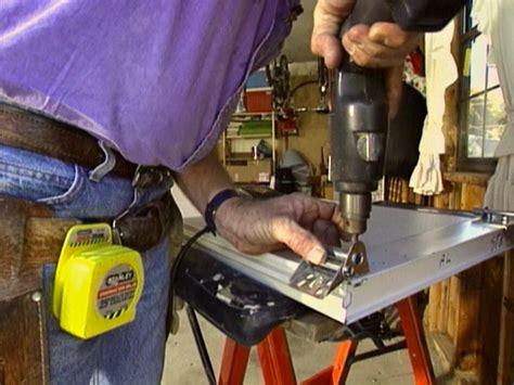 Putting A Door Into A Garage by Installing A Garage Door How Tos Diy