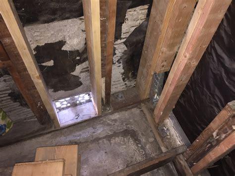 wood frame building reframed corner studs