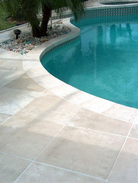 orlando travertine pool deck tropical with landscape