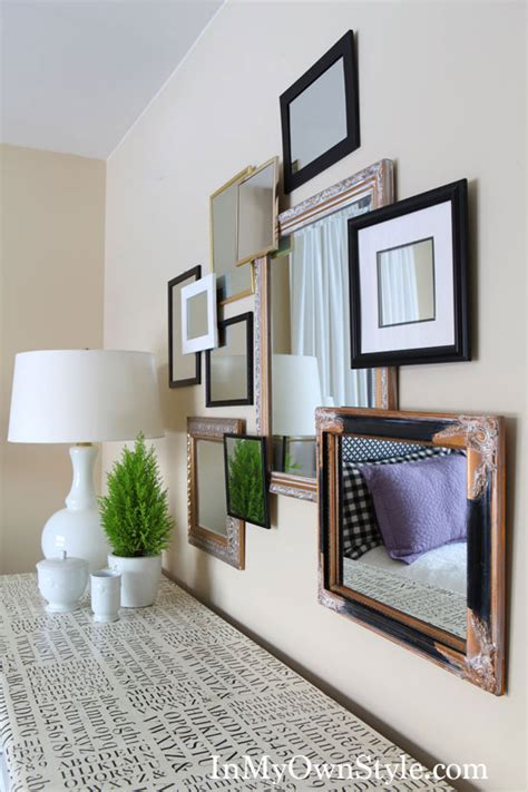 gallery wall with mirror decorating with frames