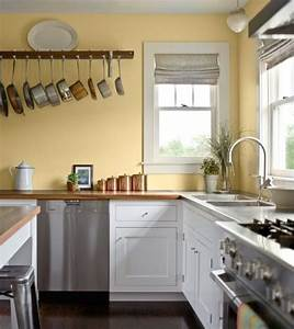 Kitchen pale yellow wall color with white kitchen cabinet for Kitchen colors with white cabinets with wall art stone