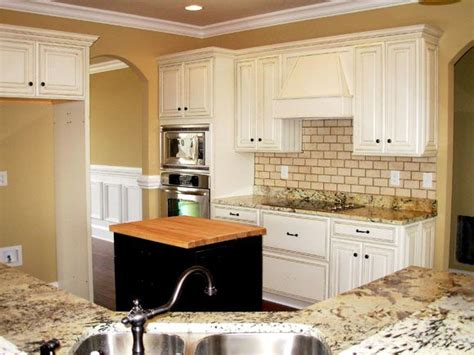 white distressed cabinets kitchen white glazed cabinets bianco antico granite subway tile 1288