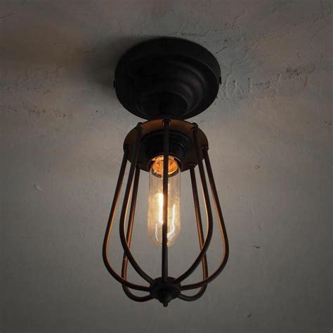 cage ceiling light pear metal cage black fixed ceiling light tudo and co