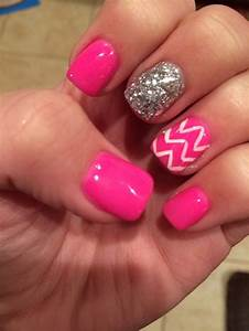 White chevron and hot pink nails with a glitter accent