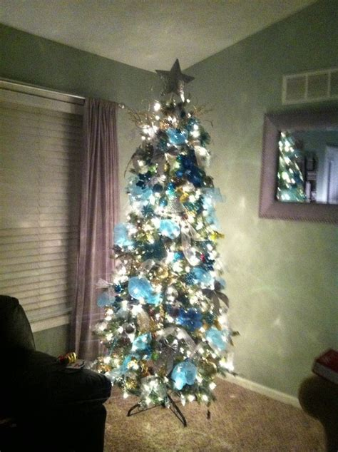 modern decorated christmas tree with teal gold and silver