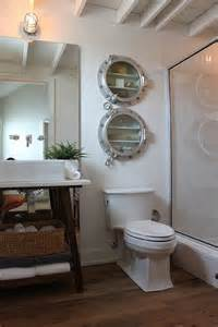 nautical bathroom with porthole medicine cabinets