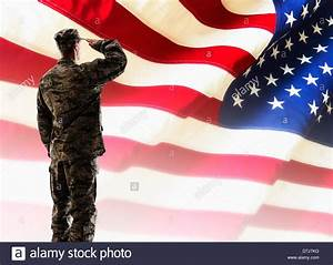 Army soldier saluting in front of American flag Stock ...