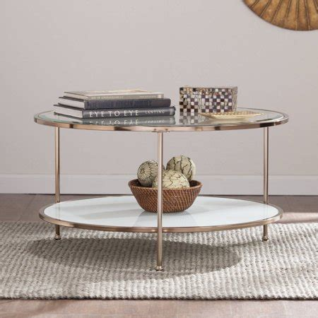 Made entirely of metal, the frame has a bronze finish whereas the tabletop has a gunmetal finish. Rambix Glam Round Coffee Table, Gold by Ember Interiors - Walmart.com