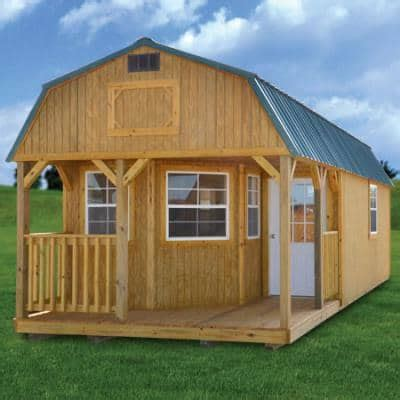 A double bed in the owner's cabin, adjacent to the. Affordable Modular Cabins For Sale Online- Shed with log store