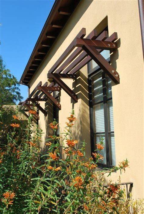 rustic exterior awnings casement windows stucco wall overhang arbor trellis layout