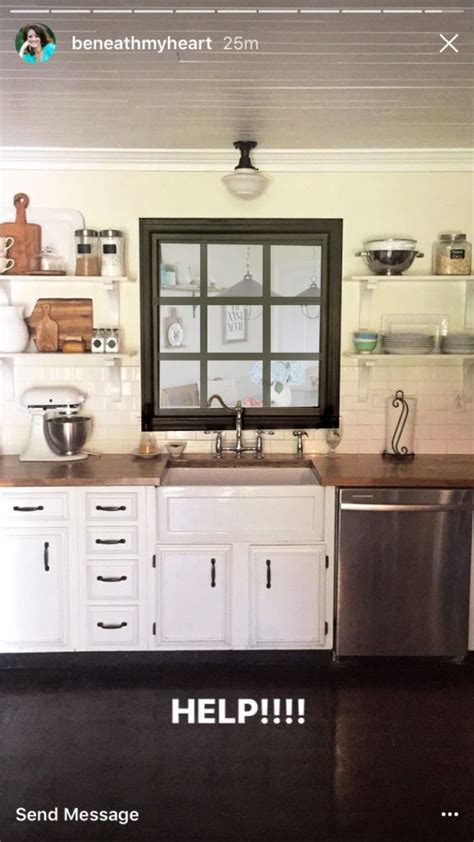 lettered cottage kitchen decorating the wall above a kitchen sink with no window 3721