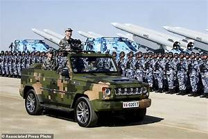 Chinese president oversees military parade in show of ...
