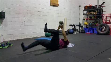 dead bug exercise kettlebell hold bottoms