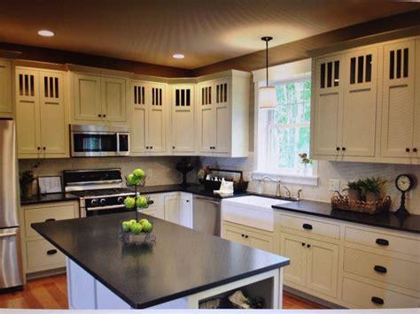 black pearl granite white cabinets backsplash