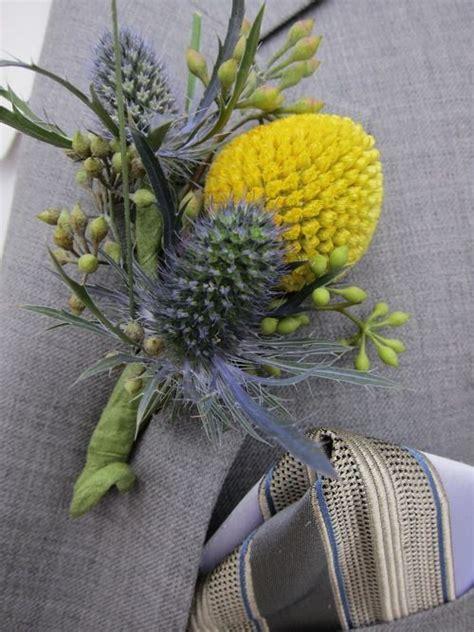 blue thistle billy ball boutonniere wedding flower girl