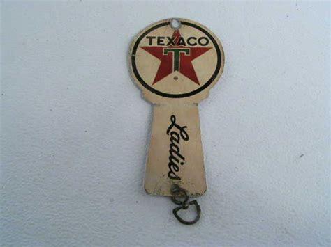 vintage exxon bathroom keys   texaco gas station