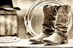 Cowboy Boots Outside Saloon Photograph by Olivier Le Queinec