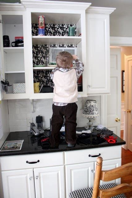 wallpaper inside kitchen cabinets 17 best images about kitchen wallpaper on