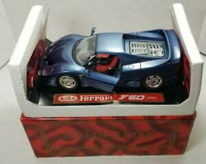Ferrari hinges are also easy to mount, with quick fastening system speed, made of an expandable dowel that is fixed with only half turn of a screwdriver. MIRA 1995 Ferrari F50 1:18 Metal Blue Car #6201 - Open Doors - Made in Spain | eBay