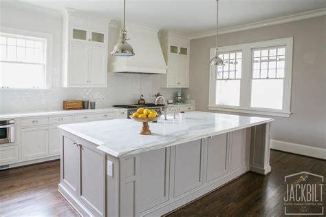 white kitchen  grey island transitional kitchen