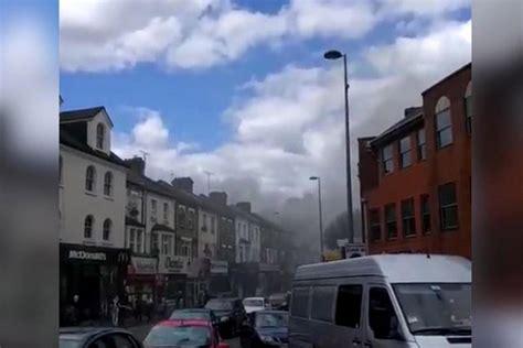 walthamstow fire smoke billows  sky  dozens