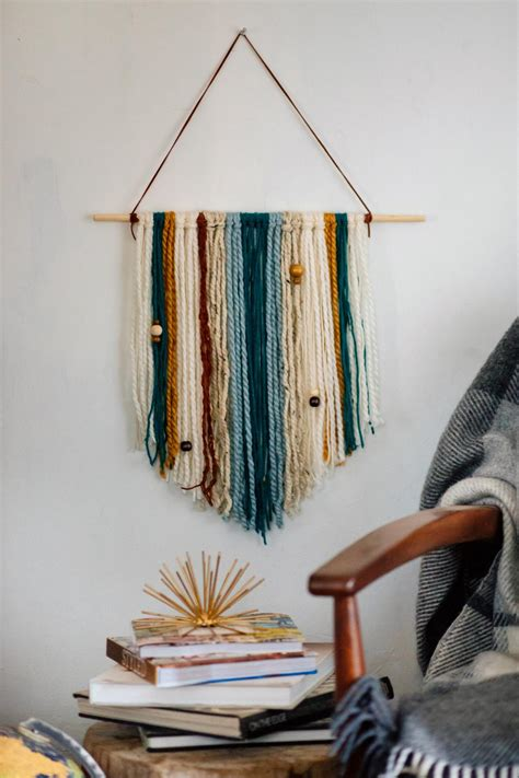 easy diy yarn wall hanging hgtv
