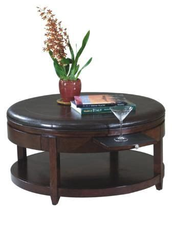 """30 inspirations of round upholstered coffee tables. Round cocktail ottoman with casters. Pull out trays for drinks and drawer for storage. 40""""W ..."""