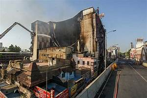 Insurance team inspects fire-hit textile emporium - DTNext.in