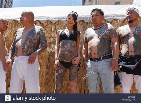 participants showing  full body tattooed possibly