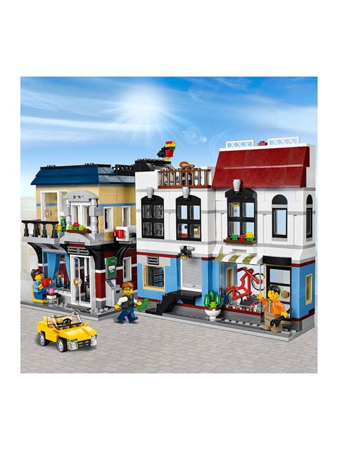 Lego® lego creator sets are a great childrens toy. LEGO Creator 3-in-1 Bike Shop & Cafe at John Lewis & Partners