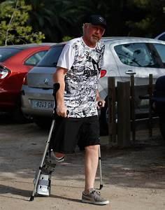 Boris Becker struggles on with crutches beach holiday ...